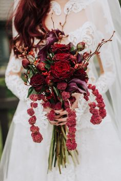 a deep red wedding bouquet with touches of purple and cascading elements okus blooming branches is elegant and decadent - Weddingomania Deep Red Wedding, Burgundy Wedding Cake, Red Bouquet Wedding, Garden Roses Wedding, Beach Wedding Flowers, Monochrome Weddings, Burgundy Flowers, Red Roses, Blush Flowers