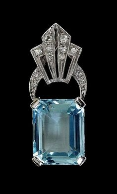 An Art Deco Aquamarine and Diamond Pendant corner.