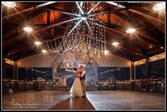 Gorgeous rustic farm venue with a barn | indoor and outdoor wedding space | stone fireplace | outdoor lighting | wedding venue near Columbia SC | Blythewood SC