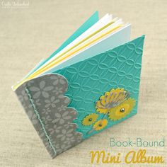 Learn how to make a book-bound mini album for gift giving or to keep for small mementos for yourself. The stitched binding is as pretty as it is functional!