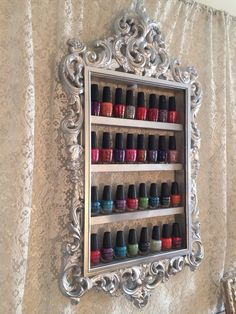 This31x17 inch antique looking frame is made to display around 36 bottles of nail polish. The frame is molded acrylic and the shelves are solid