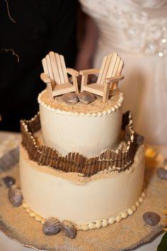 My beach wedding cake by Sharon Garner in Mendocino, California. Dark chocolate seashells, graham cracker crumb sand, chairs and fence from a dollhouse furniture store