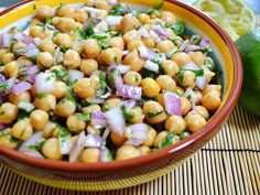 Cumin Lime Chickpeas: 2 (15 oz.) cans chickpeas (garbanzo beans), ½ medium red onion, ½ bunch cilantro, 2 cloves garlic, 1 medium lime, 2 Tbsp olive oil, 1 tsp cumin, ⅛ tsp cayenne pepper, ¼ tsp salt. Another interesting twist to this salad would be to add a touch of honey and chopped jalapeno.