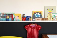 one wall with shelf and chalkboard paint underneath and hooks under shelf.