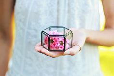 We know you are unbelievably excited for what the future has in store for your friends getting married. Meanwhile, you might want to give them a unique gift so they can store their new bling. This glass geometric ring bearer box with its hexagon lid on top, is all devoted to keep the rings safe and to look beautiful at the same time. We bet they will love it! This stained glass geometric ring box is handcrafted from 2 mm clear glass which is cut by hand and the edges are then ground smooth…