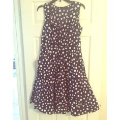 Vintage sailer inspired polkadot dress Vintage sailer style collared dress with buttons all the way down the front. Super cute dress with empire waist. Loops for a belt. This is a size XL, but it fits more like a L which is why it's listed in that size. Vintage Dresses