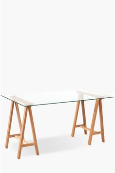 This glass trestle desk with wooden legs is perfect for any home office. Glass Hardwood legs Assembly requiredDimensions:L Home Office Furniture, Online Furniture, Trestle Desk, Glass Desk, Wooden Desk, Mid Century Furniture, Hardwood, New Homes, Office Desks