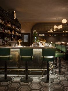 The Caprice Restaurant Group | Bespoke bar stools in green leather by Andy Thornton