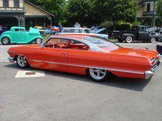 1963 Chevy impala  Love that orange....Brought to you by agents at #HouseofInsurance in #EugeneOregon for #LowCostInsurance.