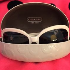 Authentic Coach Sunglasses Super cute authentic Coach sunglasses. Slight wear but in great condition. Slight color change around the top of the sunglasses due to wear. Very hard to notice. Coach logos on the arms. Comes with Coach hard shell case. Coach Accessories Sunglasses