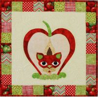 Pippin Puss Wall Quilt Kit is number 24 of the Garden Patch Cats.  I made this model for Happy Apple Quilts and used free motion quilting to finish it.
