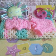 Handmade gifts are cherished by a mother-to-be to receive in addition to a baby registry gift item. Here Beverly crocheted a granny square baby blanket with matching hat and booties, and Jessica sewed a baby rattle by hand. What a sweet baby shower gift!!