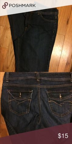 A boot cut pair of jeans These are soft and comfy pair of jeans. They have been worn a few times they still look new. Nine West Jeans Boot Cut