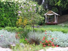 This canopied daybed provides a secluded garden retreat.