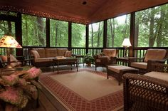 This beautiful screened porch replaced an old deck and includes a stunning gabled beadboard ceiling, Trex decking, and a pass-thru counter to the kitchen.