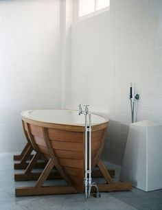 The Viking bath tub. !  !  ! My Norwegian dh would love this!  he could wear his horn helmet while bathing!