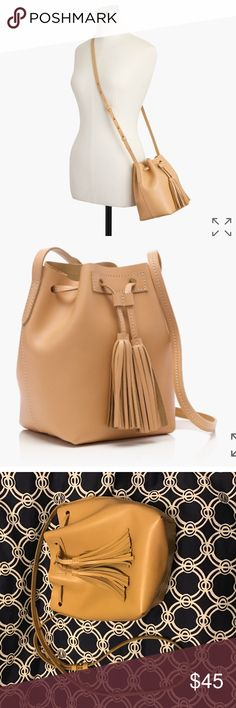 """Jcrew mini bucket bag - SOLD OUT Used for a few months. Excellent condition. Some pen on the liner (see photos).                   8 3/8""""H x 5 3/4""""W x 5 1/4""""D. Adjustable shoulder strap fully extends to 24"""" shoulder drop. PRODUCT DETAILS Our newest bucket bag is crafted in a smooth, structured leather and features a tassel drawstring closure and a handy interior pocket (so you don't have to dig for your ID/lipstick/phone).  Genuine leather. Unlined. Import. Item E8032. J. Crew Bags"""