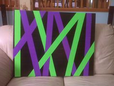 Did this for my daughter's room.  Black painted canvas with bright duct tape.