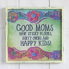 """Good Moms Have Sticky Floors Big Bungalow Art  - Add color and cheer to any room. Printed wood wall art with """"Good Moms Have Sticky Floors, Dirty Ovens And HAPPY KIDS!"""" over a colorful turquoise, green, yellow and orange background, with brightly colored flowers above and beneath. Funny and oh-so-true sentimental art for your favorite hard-working mom!"""