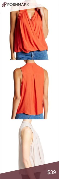 Free people blouse Orange. Size L. NWT. Will add photos and description soon. Free People Tops Blouses