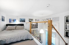 photo of white bedroom mezzanine with glass balustrade