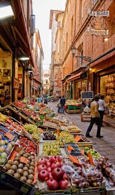 Bologna, Italy. My favorite part of Italy is the sense of community. Everyone goes out daily to get lattes, fresh food, and to gossip about their lives.