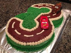 """I made this Cars birthday cake for my 3 year-old nephew.  He loved it!    It was made from two 9"""" round cakes, and lots of butter-cream icing. Instead of oreo cookie crumbs for the road track, as suggested on the website below, I used chocolate butter-cream icing.  It worked really well.This was not hard to make at all, and I'd do it again! The cake is a vanilla 1-2-3-4 recipe from Paula Dean's website. Instead of three 9"""" rounds, I poured the batter into two pans, making a thicker cake."""
