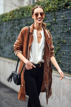 Model Alana Zimmer gave a dreamy velvet jacket an off-duty touch with round metal-rimmed sunglasses, a white blouse, belted black jeans, and a chic mini Gucci bag. We could totally live in this for fall.