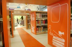 Gaps between shelves in the Children's Library become tunnels to explore. (Greg Cook) Boston Public Library