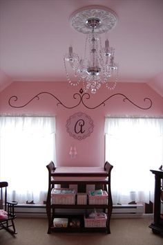 Simple touches jazz up this pink nursery