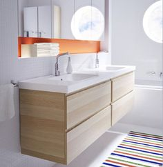 Bathroom Simple Ikea Bathroom Cabinet Design Ideas With Charming Floating Wood Vanity Bathroom On Combined Stylish Twins Undermount Trough Sink Bathroom And Modern Stainless Single Bathroom Faucet Also Delightful Colorful Striped Rug Using White Wall Paint: Stunning Ikea Bathroom Cabinets Design For Modern Bathrooms