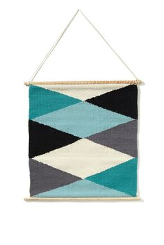 Hanging around never looked so good! The new wall hangings hit all the right spots and are completely swoon worthy. Each piece is hand-woven meaning that every hanger is as unique as you are. A gorgeous woven woollen argyle design that is sure to inspire with every glance.  Each is individually hand made in India and features MDF rods on top and bottom with cotton hanger. Dimensions: 53cm wide x 50cm length.