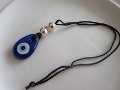 Blue glass teardrop pendant on a black cord rear by LeeliaDesigns