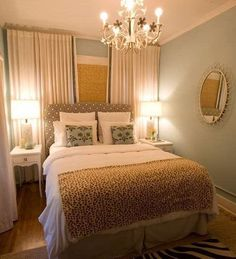 Small Master Bedroom Decorating Ideas... lots of lighting makes it look larger than it is!