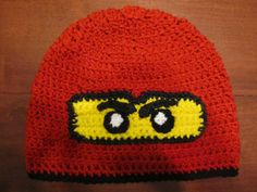 Lego Ninjago Hat Handmade by twotwinklestars on Etsy, $18.00  I had this made for Huck and we love it.