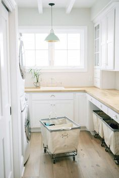 laundry with Built-in cabinets, a butcher block countertop and a beautiful wood floor