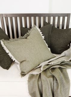 HIMLA Merlin cushion and throw in twill linen and wool.