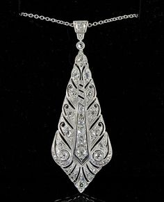 Edwardian or Art Deco 1.30 Ct old cut diamond long lonzenge pendant and chain 1920