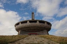An abandoned saucer-shaped monument in the Bulgarian mountains.