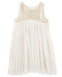 With pretty pleats, a splash of sparkle and an all-around flowy feel, this dress is built to twirl.