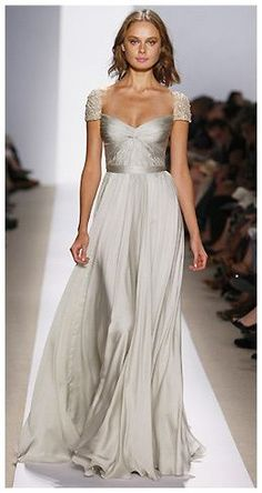 Shimmery, floaty wedding dress with cuff sleeve detailing. Bring out your inner goddess.