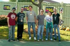 With the headliners Godsmack, Big Gig, May 2012!  L. to r.:  Robbie Merrill, Tony Rombola, my husband Steve, Sully Erna, I and Shannon Larkin!  Mona Lisa smile and she's not even looking at the camera!  Love it and what perfect weather as well as concert.  Godsmack were a pleasure to meet and killed it with their killer set as always too!