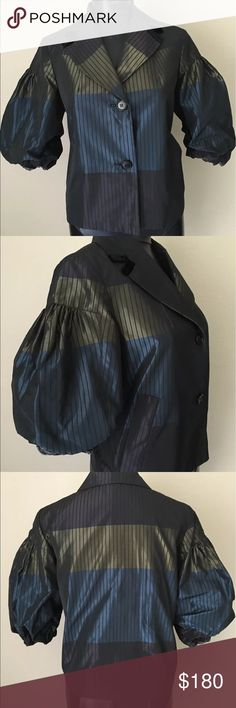 """Etro blazer fashion balloon sleeve iridescent Etro Jacket with gathered balloon sleeve with 2 button front. Beautiful detailed jacket features notched lapel valore detail. Multicolored Colorblock with pinstripes. pristine condition Italian size 44 size 10 US.  • 1/2 balloon sleeve • Lined inside • 2 button Front closure • Black velour detailing on lapel  • Duel slanted welt pockets on side  • 100% polyester  • 50% Acetate 50% Rayon lining • Shoulders 16""""  • Bust 38""""  • Waist 38""""  • Sleeve…"""