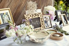 An eclectic mix of frames, flowers and other sentimental items.