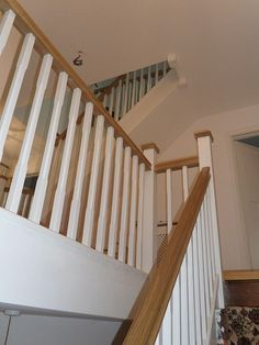 A softwood winder staircase for a loft conversion, painted white with feature oak handrail and newel caps. A softwood winder staircase for a loft conversion, painted white with feature oak handrail and newel caps. Staircase Banister Ideas, Oak Handrail, Stair Banister, White Staircase, Winding Staircase, Banisters, Staircase Design, Staircase Remodel, Loft Railing