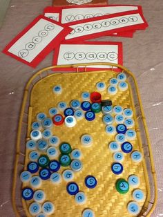 Bottle cap letters to spell names/words - Journey Into Early Childhood ≈≈