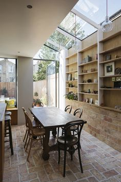 A wall of storage filled with art and ceramics features inside this house that architect Neil Dusheiko has renovated for his father-in-law, near his own home in north London. Küchen Design, House Design, Loft Design, Urban Design, House Extension Design, Interior Architecture, Interior Design, Ancient Architecture, Sustainable Architecture