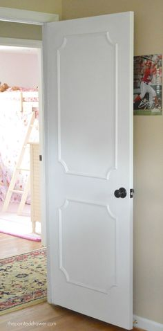 Create a Paneled Door with Moulding diywww.thepainteddrawer.com