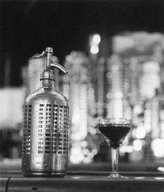 Robert Doisneau // The Bistros, Cocktail and fizzy water bottle, 1956. ( http://www.artnet.fr/artistes/robert-doisneau/verre-et-siphon-UiFymnRLPPH_HphCaycCuQ2