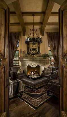 There is definitely a time-worn, exposed hewn beam look to this old world designed room. The muted gold is an old world paint color also.
